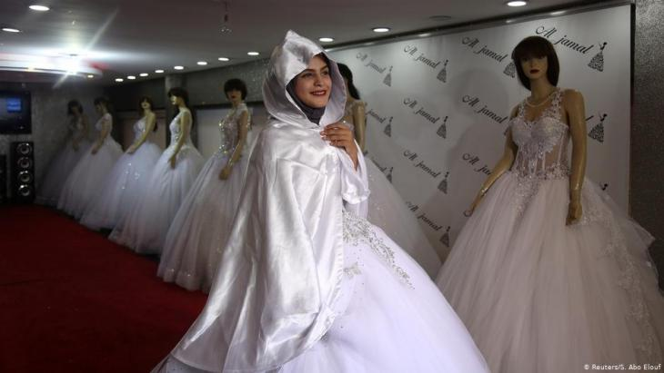 High school student Hana Abu El-Roos tries on a dress as she prepares for her wedding, in a store in Gaza City, November 26, 2018 (photo: Reuters/Samar Abo Elouf)