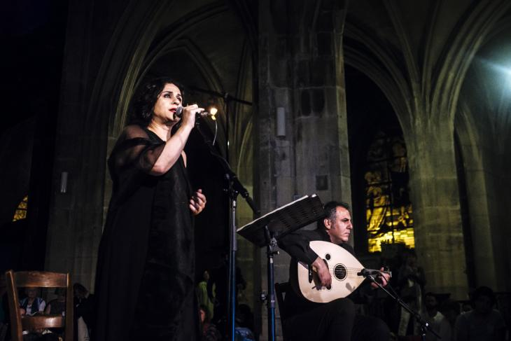 "Syrian opera and lyric singer Noma Omran and oud player Mohannad Al Garamani perform during the ""Nuit Sacree"" on 4 June 2017 (photo: Jan Schmidt-Whitley / Le Pictorium)"