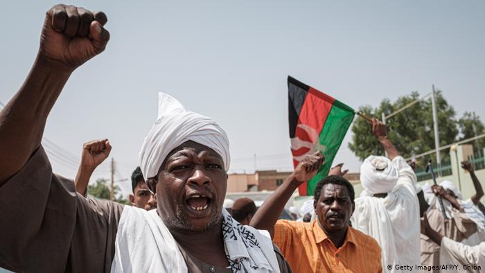 Sudanese men protesting (photo: Getty Images/AFP/Y. Chiba)