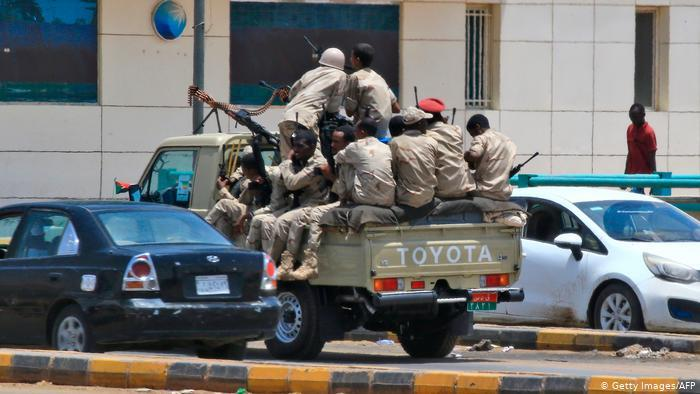 Soldiers sit on the back of a military car (photo: Getty Images/AFP)