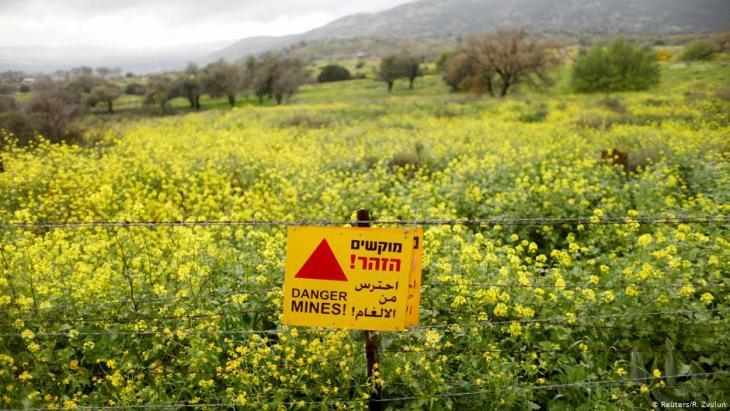 A sign warning of landmines is seen on a fence in the Golan Heights, the territory that Israel captured from Syria and occupied in the 1967 Middle East war (photo: Reuters/R. Zvulun)
