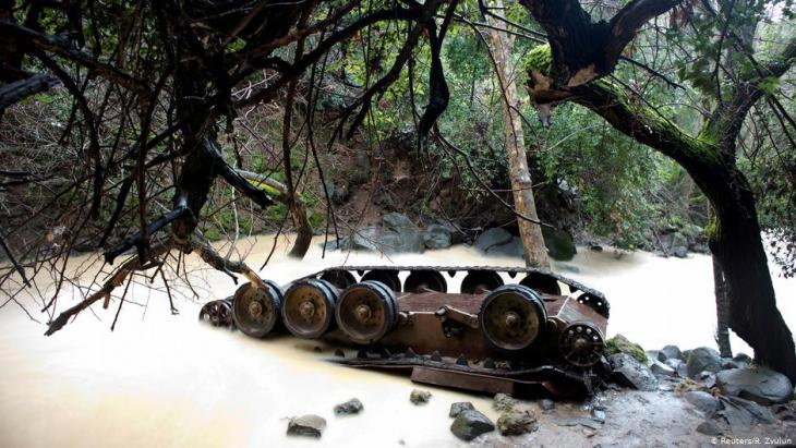 An overturned Syrian tank lies in the Hermon Stream in the Banias Nature Reserve on the western edge of the Israeli-occupied Golan Heights (photo: Reuters/R. Zvulun)