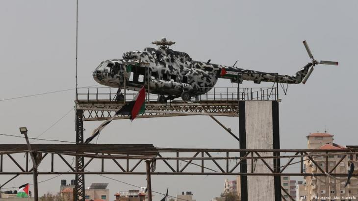 The broken helicopter of the late Palestinian Authority President Yasser Arafat sits atop a structure in Gaza City. (photo: Reuters/I. Abu Mustafa)