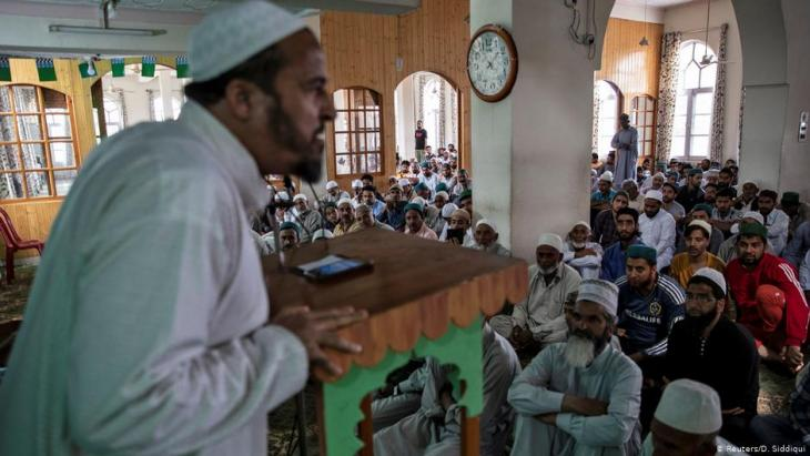 Hayat Ahmed Bhat, a Kashmiri activist speaks to residents before Friday prayers and protests inside a mosque (photo: Reuters/D. Siddiqui)