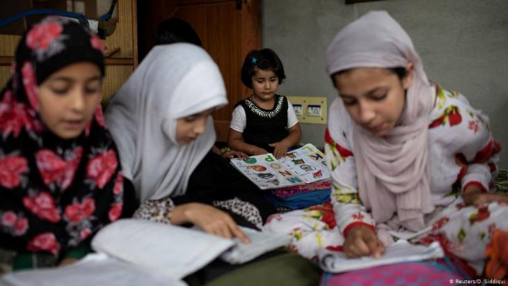 Children study at a temporary education centre inside a house in Anchar, Srinagar, 20 September 2019 (photo: Reuters/D. Siddiqui)