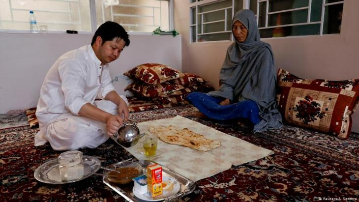 Sardar Sahil, 30-year-old Hazara lawyer and rights activist, eats his breakfast with his mother at his home in Hazara Town, Quetta (photo: Reuters/A. Soomro)