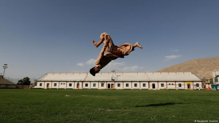 Syed Raza Hazara, 18, back flips as he performs Parkour at the Qayum Papa Stadium in Mariabad, Quetta, Pakistan (photo: Reuters/A. Soomro)