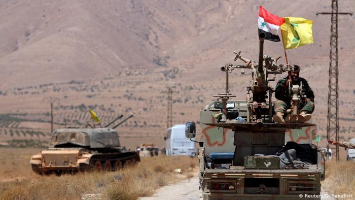 Hezbollah and Syrian flags in Qalamoun, Syria (photo: Reuters/O. Sanadiki)