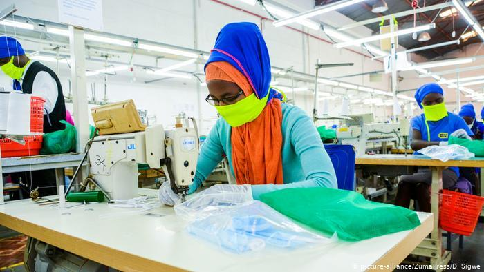 An employee at Shona EPZ Limited sewing face masks (photo: SOPA Images/D. Sigwe)