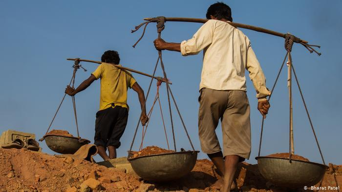 Men toiling in a mine