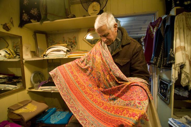 Sadiq Mohammed Wani displays a shawl made 85 years ago (photo: Sugato Mukherjee)