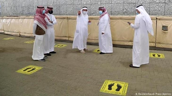 Saudi officials are seen where Muslim pilgrims will be allowed to stand to cast stones at pillars symbolising Satan (photo: Reuters/Saudi Press Agency)