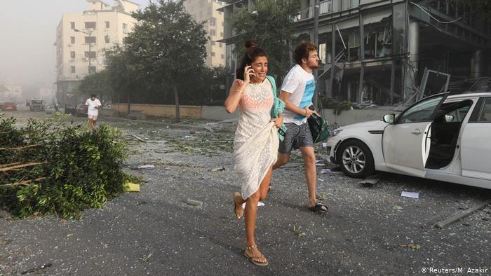 Man and woman running in Beirut (photo: Reuters/M. Azakir)