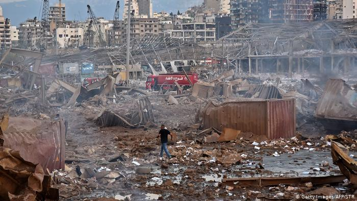 Aftermath of Beirut blasts, man walks through rubble (photo: Getty Images/AFP/STR)
