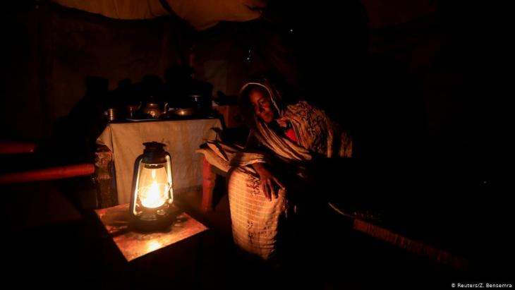 Manal, who was displaced from her home when the Nile river overflowed in September 2019, sits inside her tent in Wad Ramli, Sudan, 19 February 2020 (photo: REUTERS/Zohra Bensemra)