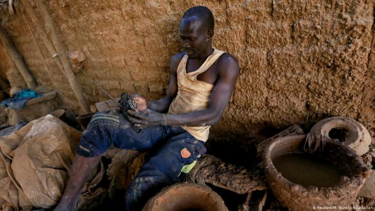 David Plantino, 35, a potter from South Sudan, listens to the radio as he rests at the pottery factory where he works, near the banks of the Nile River in Omdurman, Sudan, 18 February 2020 (photo: REUTERS/Mohamed Nureldin Abdallah)