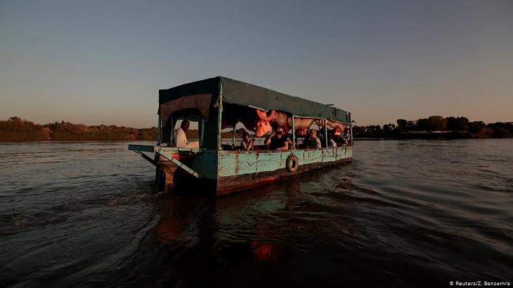 Tourists sail across the convergence between the White Nile river and Blue Nile river in Khartoum, Sudan, 15 February 2020 (photo: REUTERS/Zohra Bensemr)