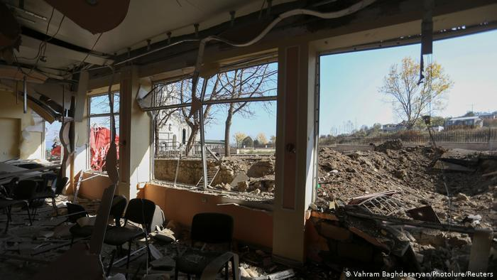 View from inside a building in Nagorno-Karabakh, the windows blown out, rubble on the floor (photo: Vahram Baghdasaryan/Photolure/Reuters)