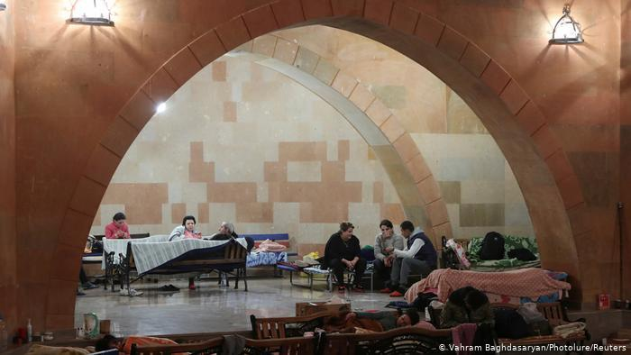 People sitting on benches, cots and chairs in a shelter in Stepanakert (photo: Vahram Baghdasaryan/Photolure/Reuters)
