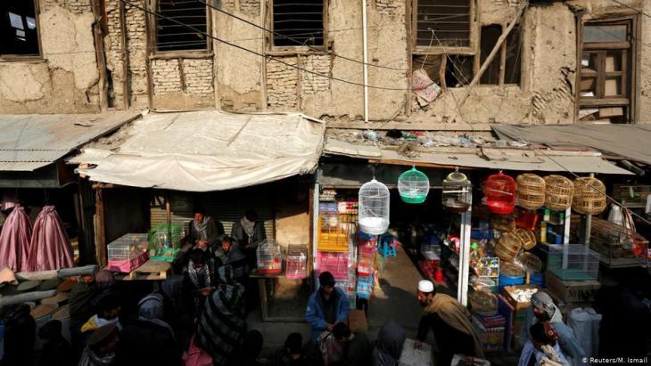 Afghan men walk at Ka Faroshi bird market in Kabul, Afghanistan (photo: REUTERS/Mohammad Ismail)