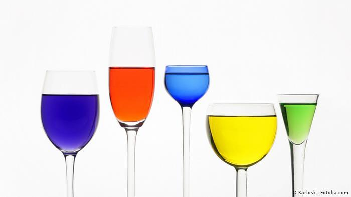 Wine glasses, different shapes, filled with colourful liquid (photo: Karlosk - Fotolia.com)