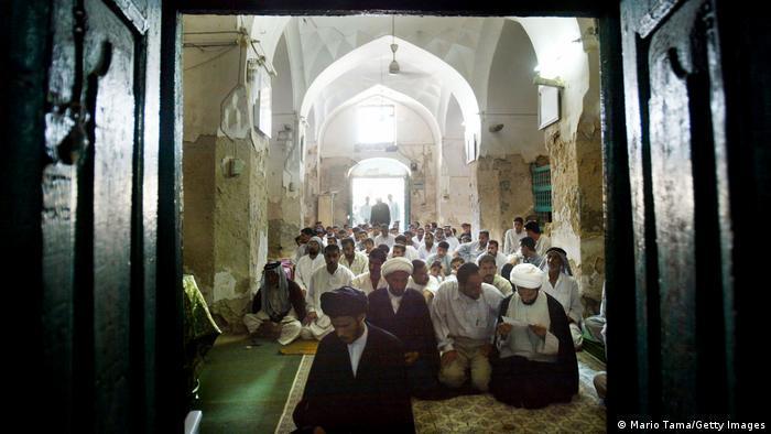 Muslims in Iraq pray in a mosque