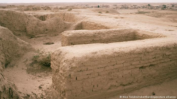 Remains of walls surrounded by arid landscape