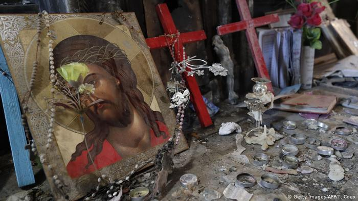 Destroyed items including a painting of Jesus