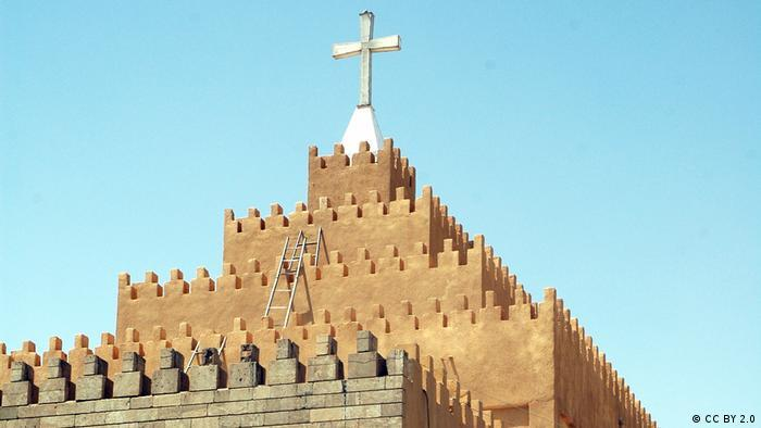 View of a church building, the Chaldean Catholic Cathedral, with a cross of top
