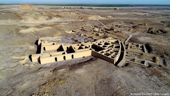 Archaeological site, walls of buildings, seen from above, arid land surrounds it