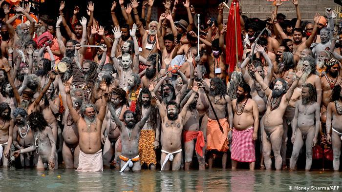 Naga Sadhus (Hindu holy men) take a dip in the waters of the Ganges river on the day of Shahi Snan (royal bath) during the ongoing religious Kumbh Mela festival, in Haridwar on 12 April 2021