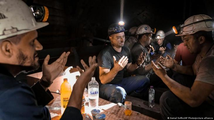 Bosnian coal miners pray after breaking fast in the underground at a mine in Zenica, Bosnia, 29 April 2021 (photo: AP Photo/Kemal Softic)