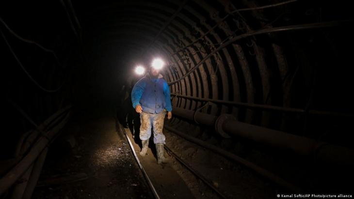 Bosnian coal miners walk in an underground tunnel at a mine in Zenica, Bosnia, 29 April 2021 (photo: AP Photo/Kemal Softic)