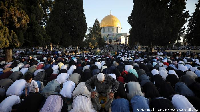 Muslims take part in Eid prayers in the Al-Aqsa Mosque compound in Jerusalem