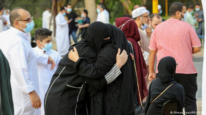 Two Saudi women hug after morning prayer