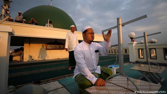 Muslims in Jakarta, Indonesia, use traditional tools to sight the crescent moon