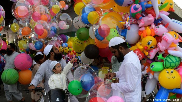 A child picks a balloon out of many in Karachi, Pakistan