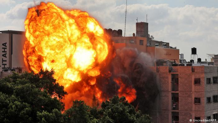 A ball of fire engulfs the Al-Walid building, which was destroyed by an Israeli airstrike on Gaza city early in the morning