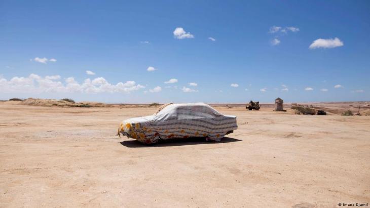 A car belonging to a guard of Sebkha Tah, a flat-bottomed geological depression, is parked at Sebkha Tah (photo: Imane Djamil)