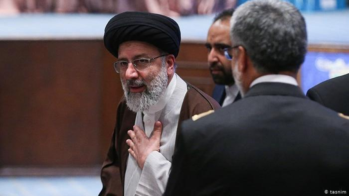 """Ebrahim Raisi, a 61-year-old cleric, is running for the second time; in 2017 he lost to incumbent President Rouhani. In 2019, he was appointed head of the judiciary by religious leader Ayatollah Khamenei and is being touted as a possible successor to Khamenei. In the 1980s, Raisi was part of the so-called """"death committee"""" responsible for executing thousands of political prisoners"""