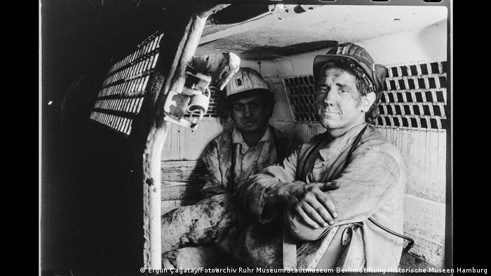 Two miners in a mine car in Walsum colliery, Duisburg