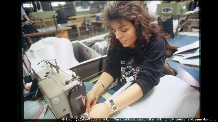 Woman upholstering a carseat