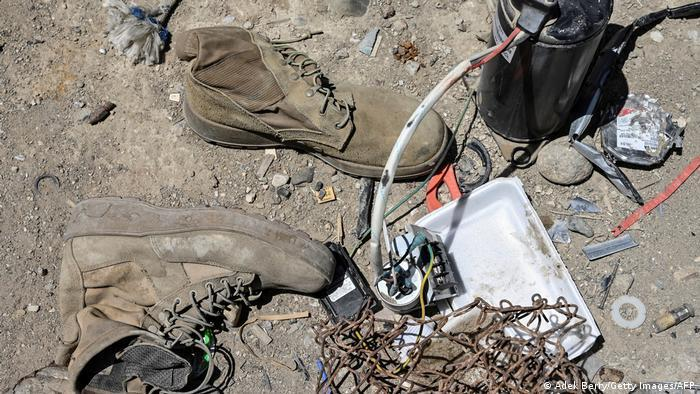 Shoes, wire and other U.S. waste on Bagram scrapyard