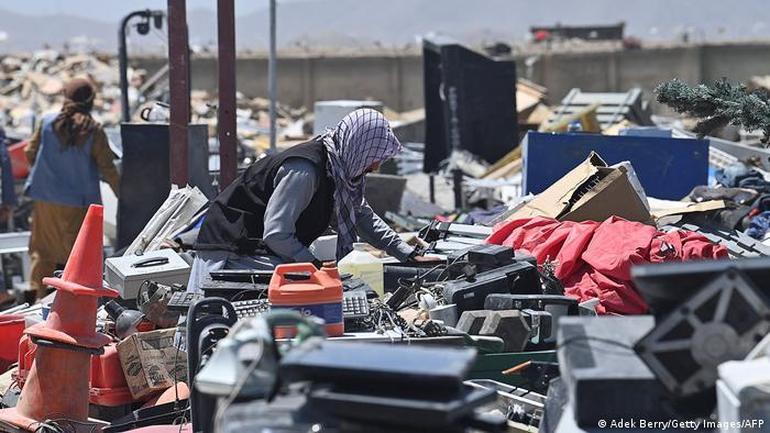 A man searches U.S. Army electronic waste in Bagram