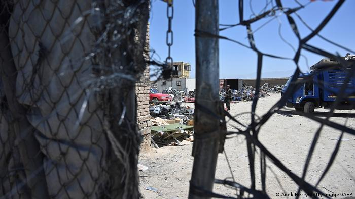 View through a barrier at Bagram scrap yard