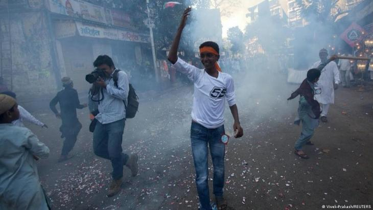 Reuters photographer Danish Siddiqui takes pictures as fireworks explode during a procession to mark Eid-e-Milad-ul-Nabi, birthday celebrations for the Prophet Muhammad, in Mumbai, India, 16 February 2011 (photo: REUTERS/Vivek Prakash)