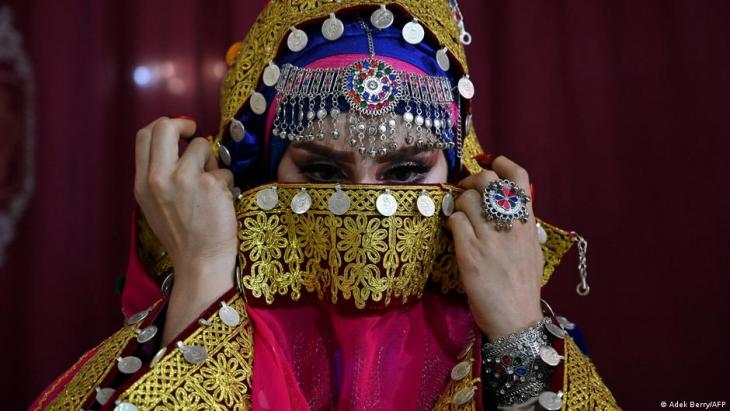 In this photo taken on June 10, 2021, a Pashtun bride wearing a traditional costume for her marriage is pictured inside a beauty parlour in Kabul (photo: Adek Berry/AFP)