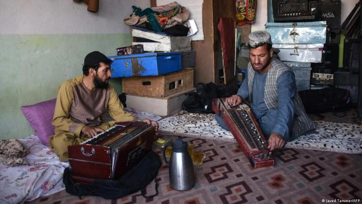 In this photo taken on 8 June 2021, professional musician Sayed Mohammad (R) rehearses with his japani, a traditional Central Asian stringed instrument, along with harmonium player Ghulam Mohammad at his music studio in Kandahar (photo: Javed Tanveer)