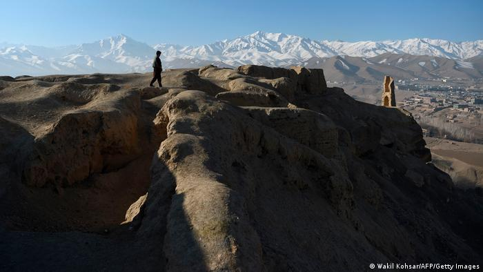 One person walks along a ridge in a mountainous area of Afghanistan