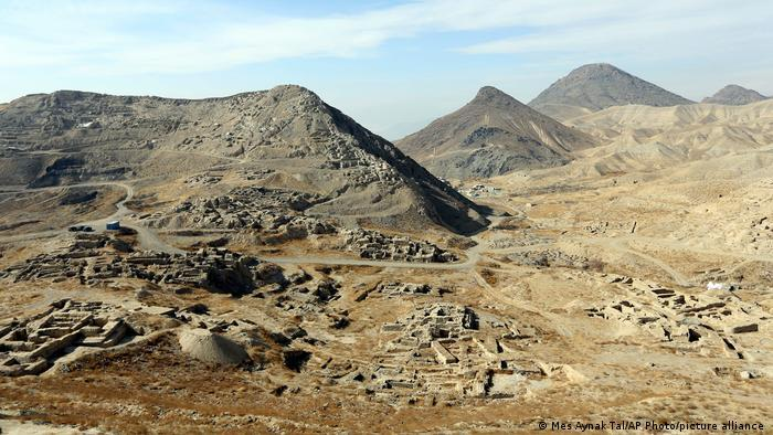 Aerial view of archaelogical site in an arid valley surrounded by bare mountains